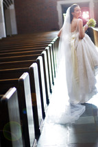 bride walking down the aisle of an empty church