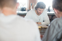 men's group gathered reading Bibles