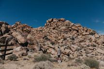 a man exploring a rocky terrain