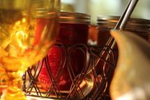 glass of water, cream, and jars of jam