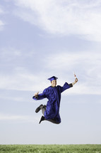 Graduate with diploma jumping for joy!
