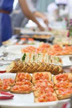 appetizers and finger foods on a buffet table