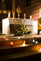 burning candles on an altar