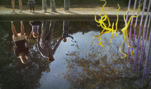 reflection of family  in water