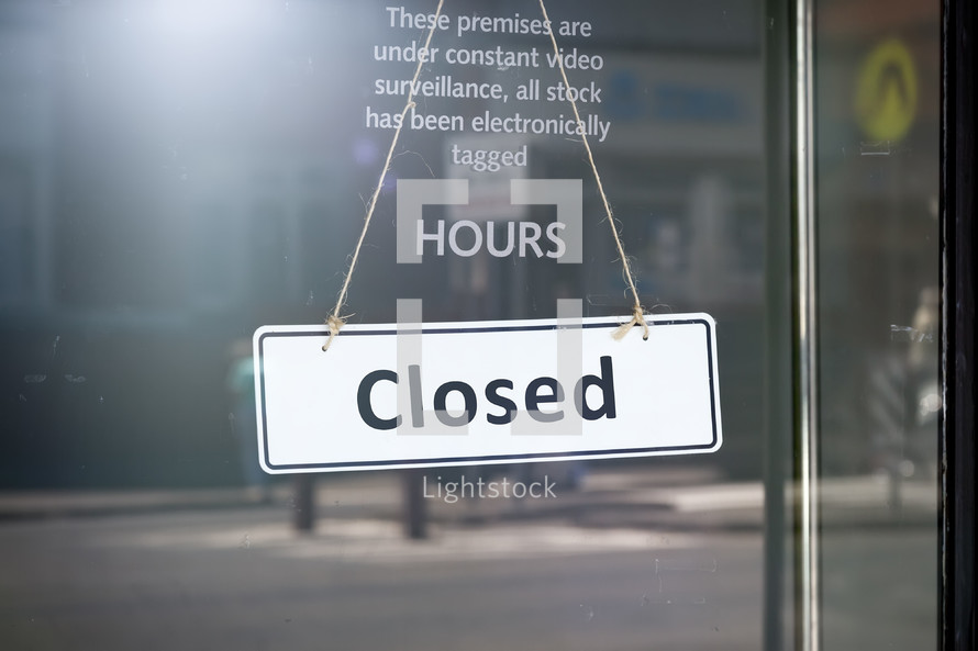 closed sign on a shop door