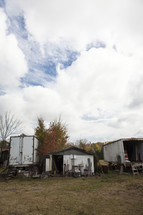 old shed and truck trailers used as storage on a farm