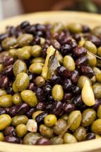 A bowl of olives.