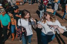 happy friends on a pier