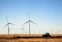 wind turbines and a tractor in a field