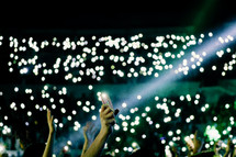 fans with raised hands at a concert