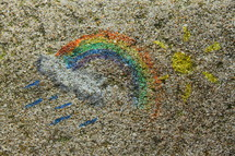 Rainbow and sun chalk art.