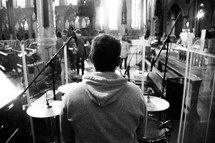 drummer in a sanctuary