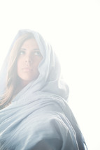 Mary in a blue shroud in bright light