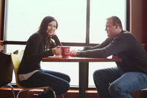 a couple having coffee together