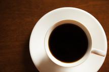 coffee mug on a saucer