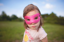 a girl child in a mask