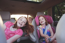 children riding in the backseat