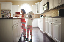 girls in pajamas in a kitchen