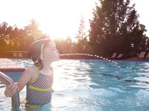 a girl child in a swimming pool