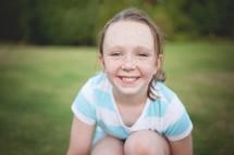 a smiling freckled face girl