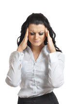 Woman with her hands pressed to her temples as if she has a headache.