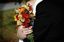 bride and groom at a fall wedding