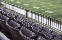 rows of stadium seats and football field
