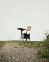 a school desk outdoors