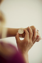 checking time on a wrist watch