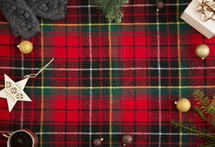 red plaid background with winter item border