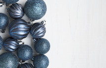 blue Christmas ornaments on a white background