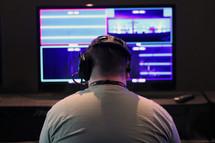 a man at a control board