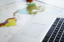 laptop on a world map