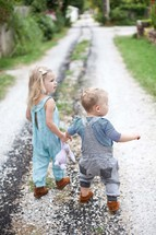 brother and sister walking holding hands