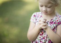 a child with praying hands