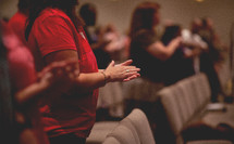 Praying hands at a worship service.