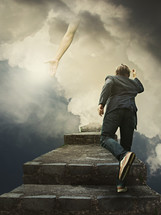 man climbing steps and reaching hand of God