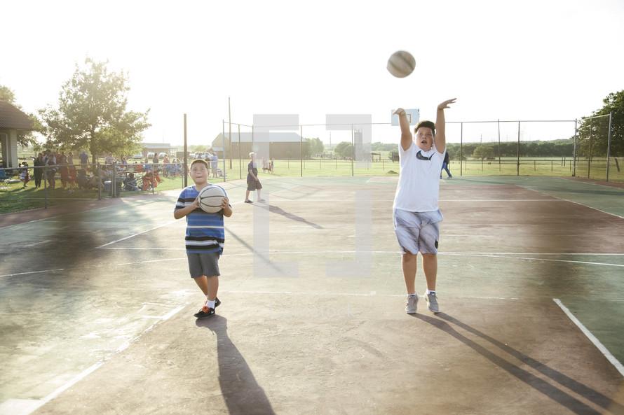kids shooting hoops