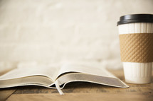 open Bible and coffee cup