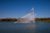 water fountain in a lake and a rainbow