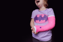 a girl child in a cast