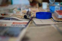 art supplies on newspaper