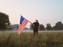 man holding an American Flag