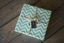a gift wrapped in chevron wrapping paper