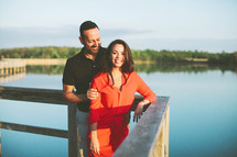 a couple standing on a dock