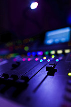 controls on a soundboard slider channel mixer audio performance