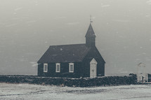 a church in the falling snow