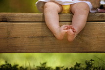 legs and feet of an infant girl