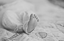 An infants bare feet.