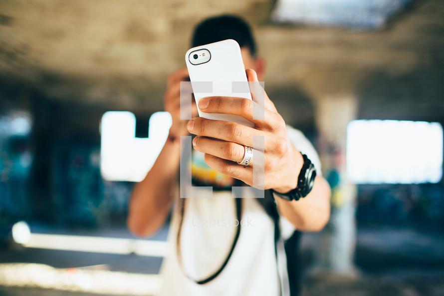 a teen boy taking a selfie